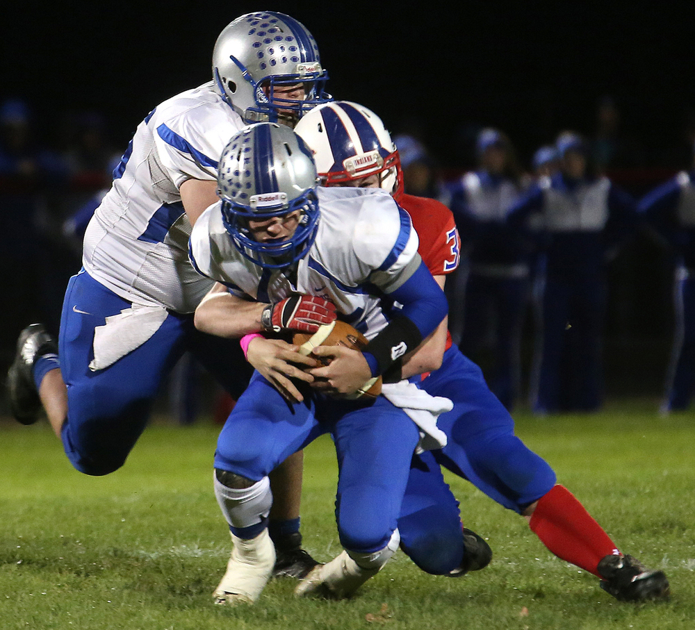 Spartans quarterback Nathan Randall is sacked by Indians defender Clay Winks. The North Greene Spartans defeated the Pawnee Indians 27-16 in the 1A football playoff game at Pawnee High School on Friday evening, Oct. 31, 2014. David Spencer/The State Journal-Register