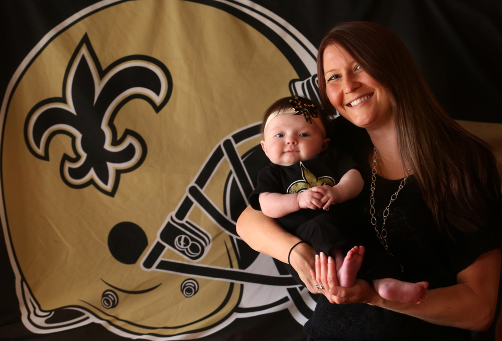 Kristin Logue holds daughter Breeson, 3 months, in their Chatham home on Tuesday, Oct. 28, 2014. Logue and her husband Jeremy named their daughter after New Orleans Saints QB Drew  Brees and former Saints player Steve Gleason, the popular former player who has ALS. David Spencer/The State Journal-Register