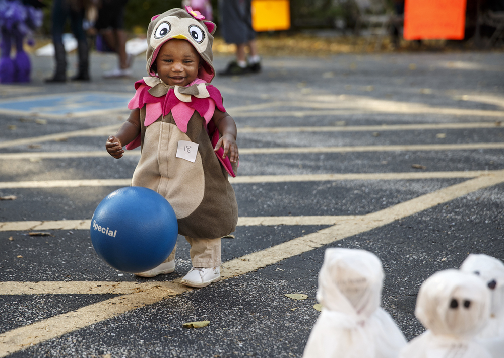 "Eleven-month-old Kenyah Craig tries to knock down the ghosts in a game of ""Booling"" at the First Congregational United Church of Christ's Trunk or Treat event Sunday, Oct. 26, 2014. Ted Schurter/The State Journal-Register"