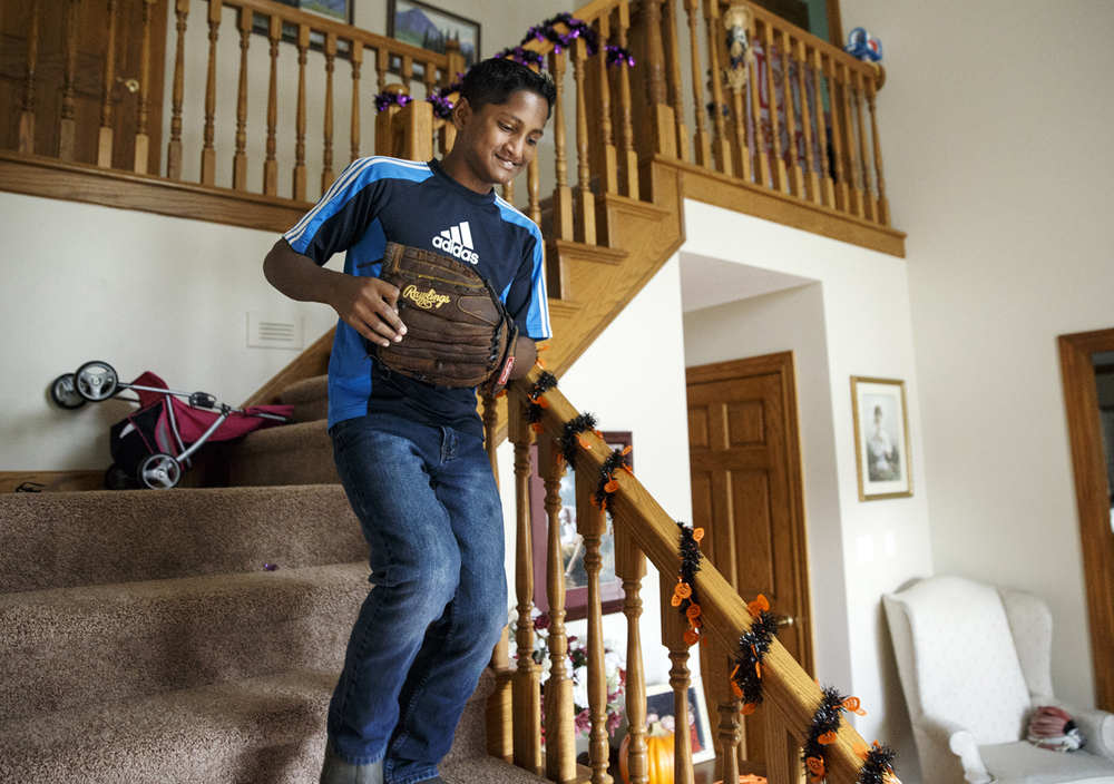 Satchian Basdeo rushes down the stairs of Dr. Kristen Ferguson's Springfield home on his way to play catch with her son Brenden Monday, Oct. 27, 2014. Ferguson brought Basdeo, who needed cleft-palate repairs after a previous surgical fix of the condition failed, to Springfield after meeting him on a mission trip to Guyana in February. Basdeo underwent the surgery for his condition in April. Ted Schurter/The State Journal-Register