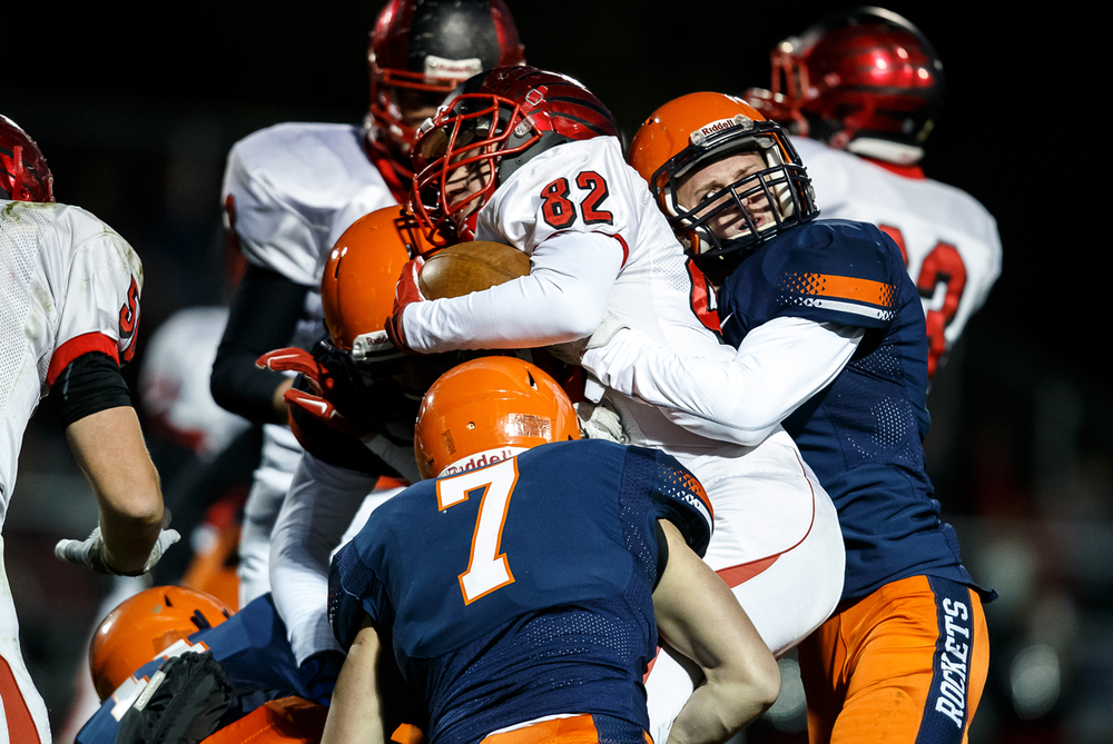 Mt. Zion's Ryan Scharf (52) is stood up by Rochester's Dallas Greer (7) and Brandon Boggs (1) in the first half during the first round of the Class 4A playoffs at Rocket Booster Field, Saturday, Nov. 1, 2014, in Rochester, Ill. Justin L. Fowler/The State Journal-Register