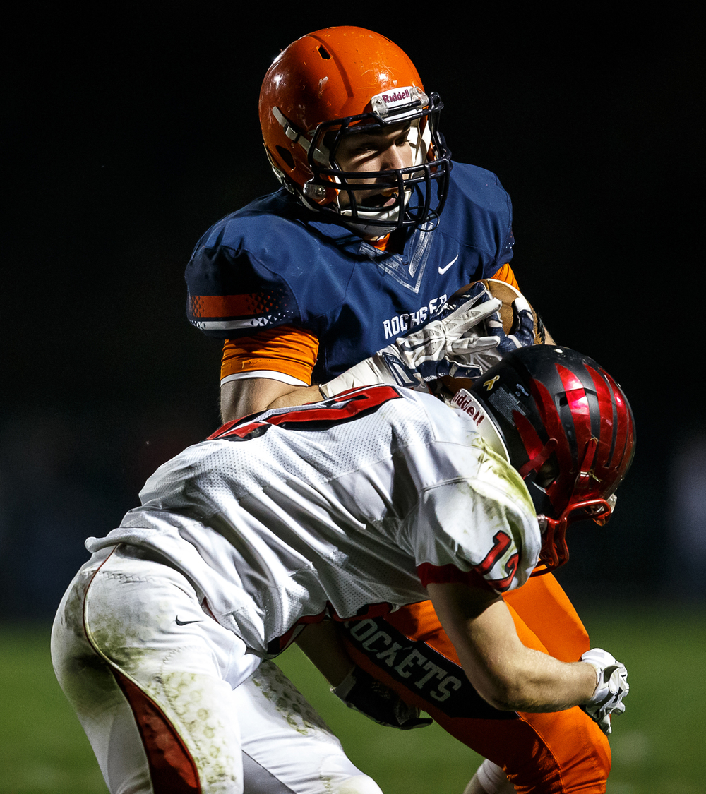 Rochester's Colten Shadis (40) spins out of tackle from Mt. Zion's Austin Thacker (12) on a rush in the first half during the first round of the Class 4A playoffs at Rocket Booster Field, Saturday, Nov. 1, 2014, in Rochester, Ill. Justin L. Fowler/The State Journal-Register