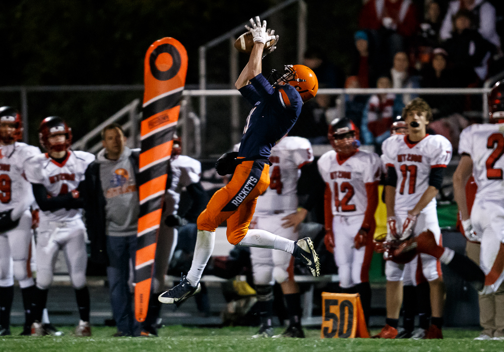 Rochester's Collin Etherton (11) pulls in a pass for a 35-yard completion against Mt. Zion in the first half during the first round of the Class 4A playoffs at Rocket Booster Field, Saturday, Nov. 1, 2014, in Rochester, Ill. Justin L. Fowler/The State Journal-Register