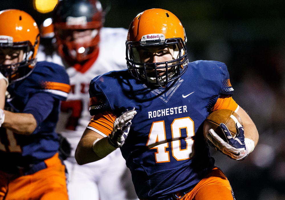 Rochester's Colten Shadis (40) goes in for a touchdown against Mt. Zion in the second half during the first round of the Class 4A playoffs at Rocket Booster Field, Saturday, Nov. 1, 2014, in Rochester, Ill. Justin L. Fowler/The State Journal-Register