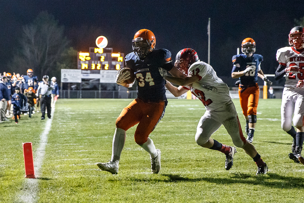 Rochester's Evan Sembell (34) avoids a stop from Mt. Zion's Austin Thacker (12) for a touchdown in the first half during the first round of the Class 4A playoffs at Rocket Booster Field, Saturday, Nov. 1, 2014, in Rochester, Ill. Justin L. Fowler/The State Journal-Register