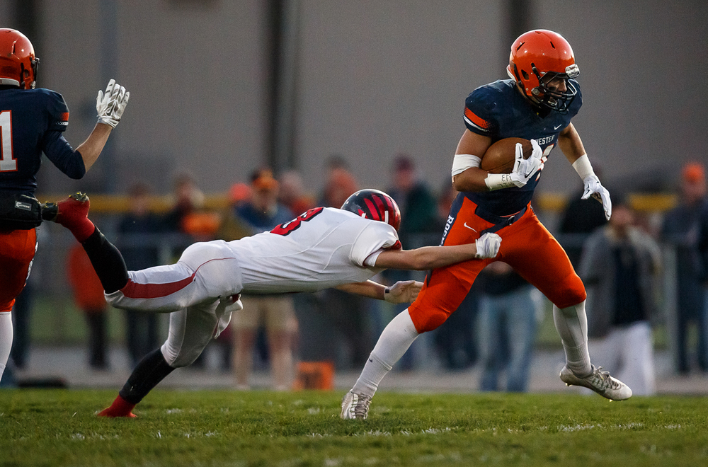 Rochester's Evan Sembell (34) breaks a tackle on a rush against Mt. Zion's Charles Kuhle (2) in the first half during the first round of the Class 4A playoffs at Rocket Booster Field, Saturday, Nov. 1, 2014, in Rochester, Ill. Justin L. Fowler/The State Journal-Register
