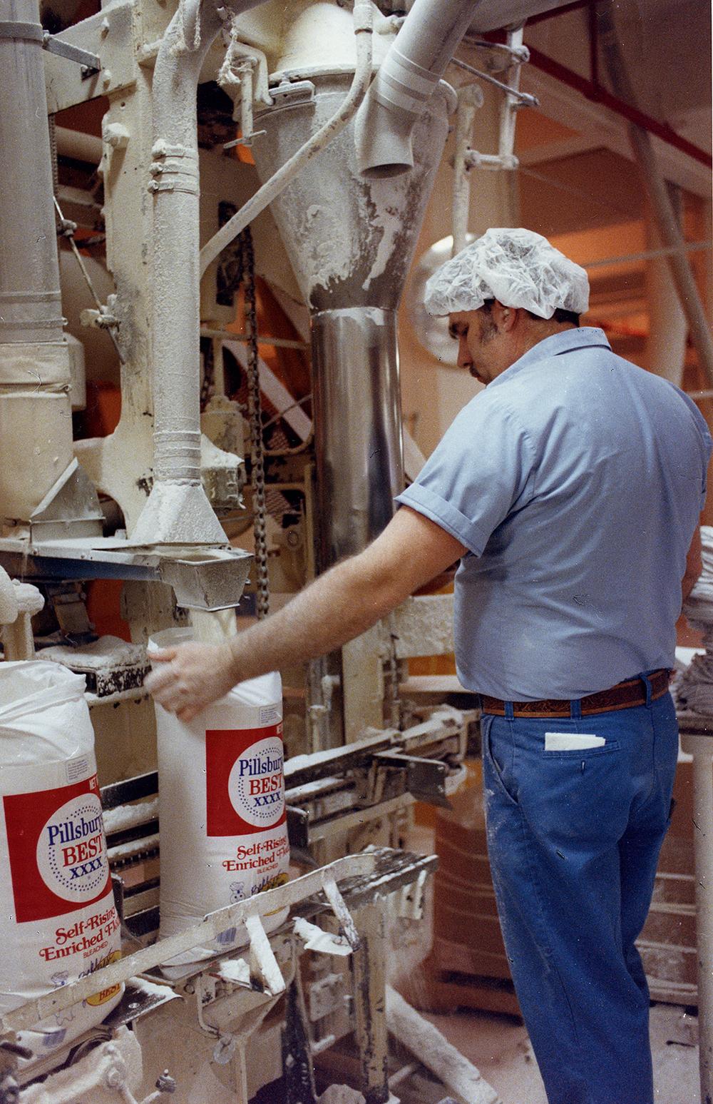 Pillsbury Mills, Feb. 1, 1989. Joe Lewis fills 25 lb. bags of flour. File/The State Journal-Register