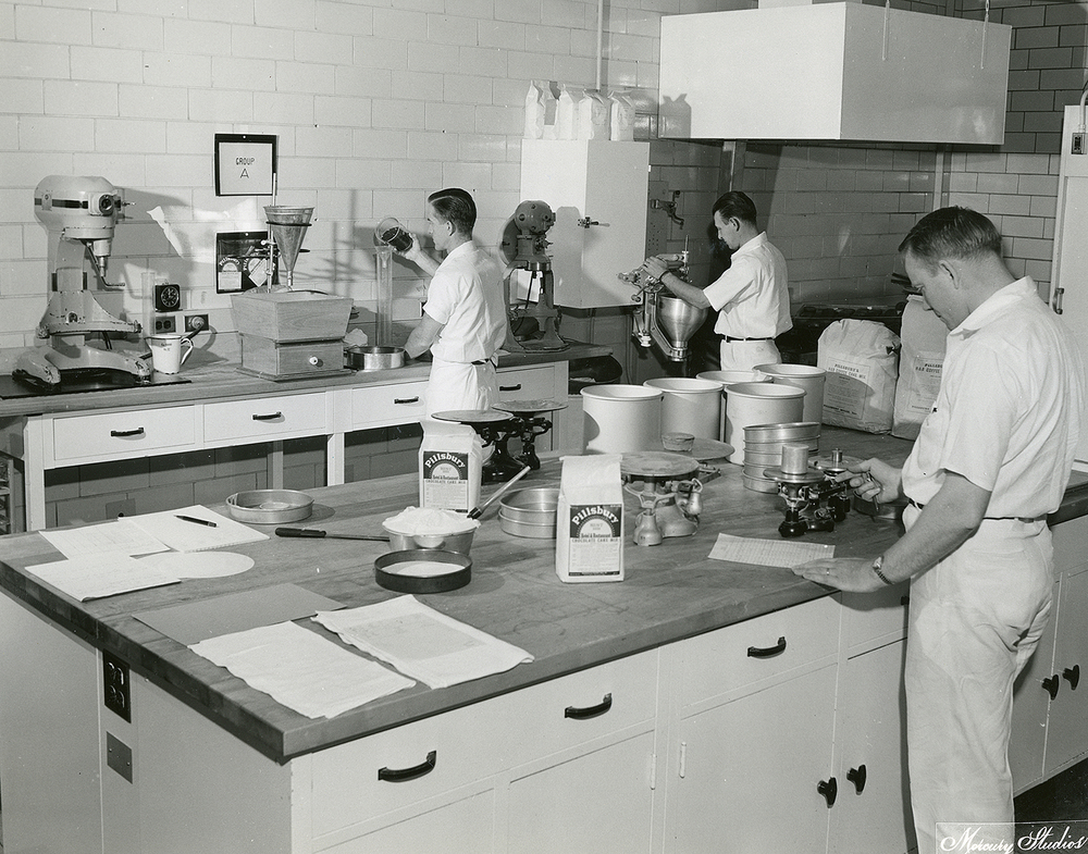 Pillsbury Mills, Sept. 2, 1955. From left, Gerhardt Voightland, William Schlack and Richard Brown in the bakery mix research and development lab. Mercury Studios collection/Sangamon Valley Collection at Lincoln Library