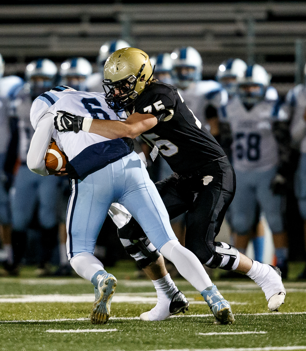 Sacred Heart-Griffin's Michael Zeigler (75) sacks Jerseyville quarterback Jacob Varble (6) for a loss of five yards during the first half of a Class 5A first round playoff game at the Sacred Heart-Griffin Sports Complex, Friday, Oct. 31, 2014, in Springfield, Ill. Justin L. Fowler/The State Journal-Register