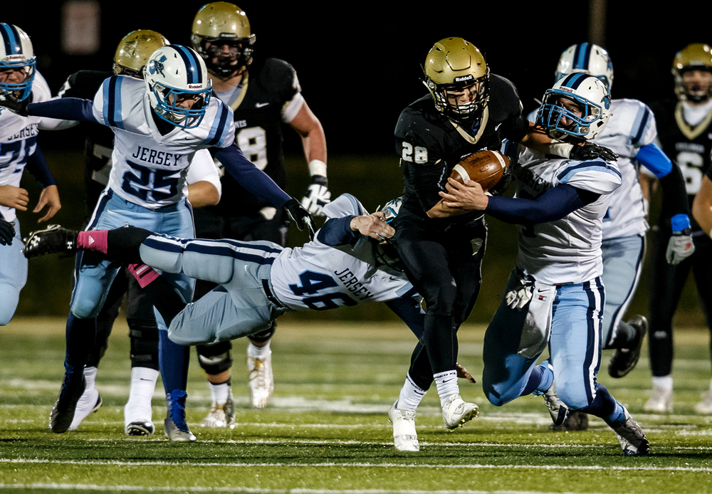 Sacred Heart-Griffin's Sam Sergent (28) breaks a tackle from Jerseyville's Brendan Kennedy (46) for a 12-yard gain and a first down during the first half of a Class 5A first round playoff game at the Sacred Heart-Griffin Sports Complex, Friday, Oct. 31, 2014, in Springfield, Ill. Justin L. Fowler/The State Journal-Register