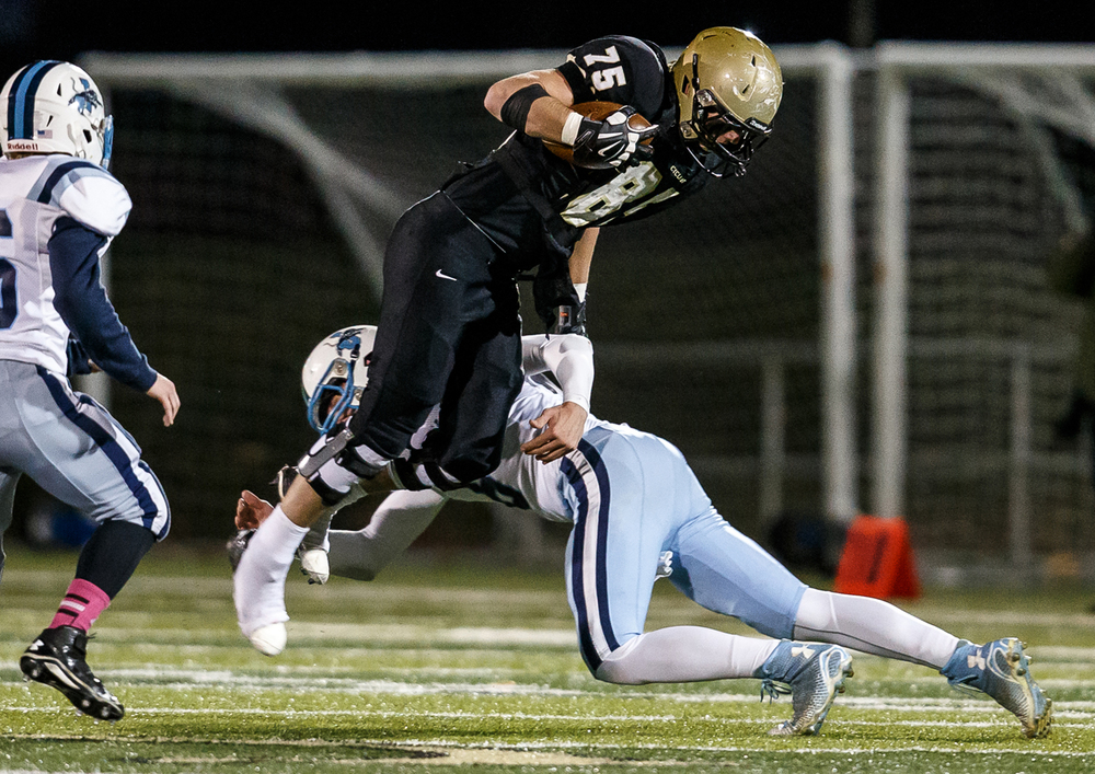 Sacred Heart-Griffin's Michael Zeigler (75) is upended by Jerseyville's Jacob Varble (6) after a catch during the first half of a Class 5A first round playoff game at the Sacred Heart-Griffin Sports Complex, Friday, Oct. 31, 2014, in Springfield, Ill. Justin L. Fowler/The State Journal-Register