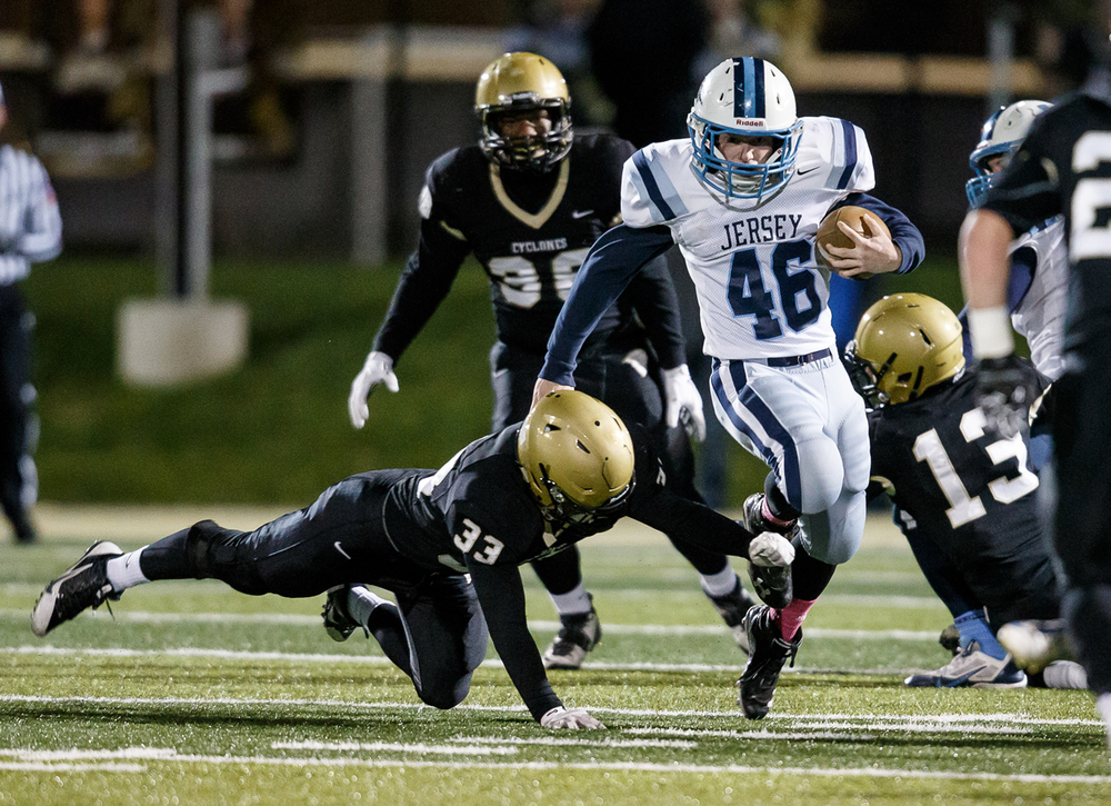 Jerseyville's Brendan Kennedy (46) is taken down on his feet by Sacred Heart-Griffin's Kyle Espejo (33) during the first half of a Class 5A first round playoff game at the Sacred Heart-Griffin Sports Complex, Friday, Oct. 31, 2014, in Springfield, Ill. Justin L. Fowler/The State Journal-Register