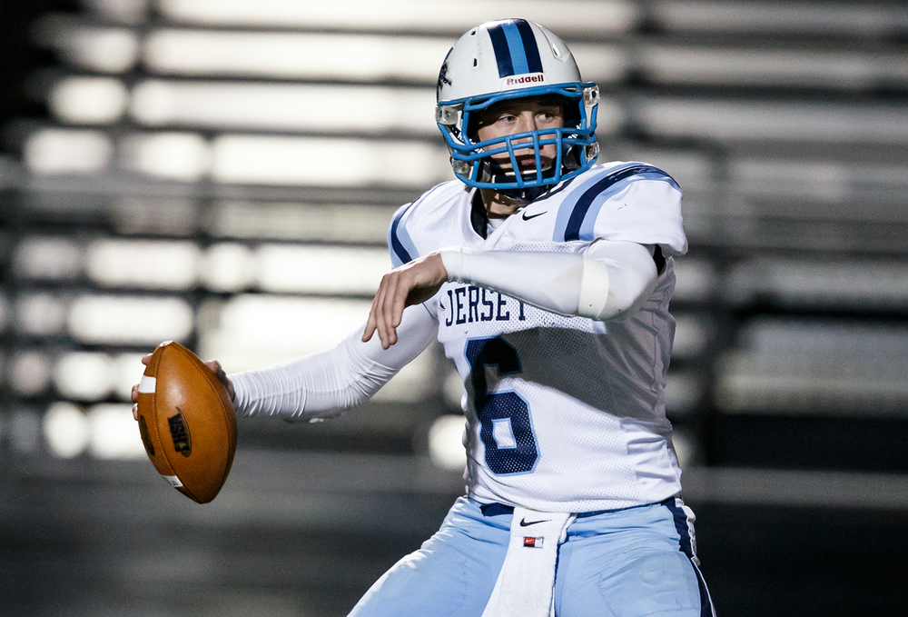 Jerseyville quarterback Jacob Varble (6) drops back for a pass against Sacred Heart-Griffin during the first half of a Class 5A first round playoff game at the Sacred Heart-Griffin Sports Complex, Friday, Oct. 31, 2014, in Springfield, Ill. Justin L. Fowler/The State Journal-Register