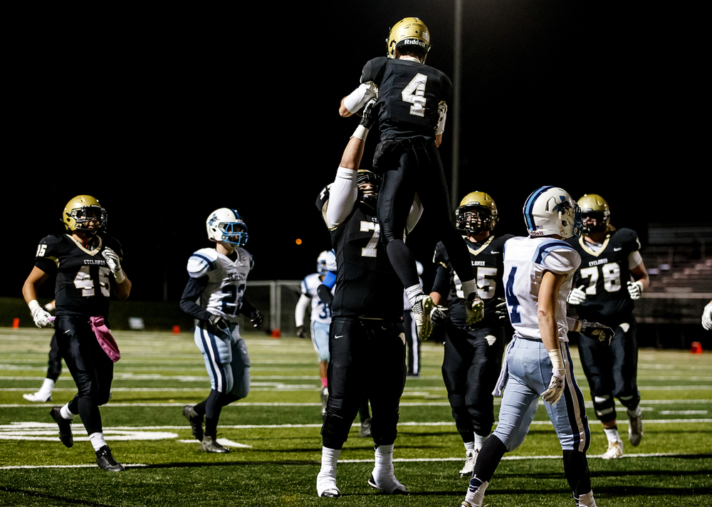 Sacred Heart-Griffin's John Fischer (77) hoists Sam Bonansinga (4) up in the air after a touchdown catch against Jerseyville during the first half of a Class 5A first round playoff game at the Sacred Heart-Griffin Sports Complex, Monday, Oct. 31, 2014, in Springfield, Ill. Justin L. Fowler/The State Journal-Register
