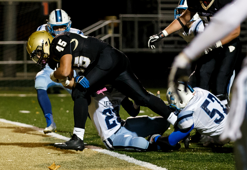 Sacred Heart-Griffin's Anthony DiNello (45) lowers his shoulder into Jerseyville's Isaac Rowling (23) for a touchdown during the first half of a Class 5A first round playoff game at the Sacred Heart-Griffin Sports Complex, Monday, Oct. 31, 2014, in Springfield, Ill. Justin L. Fowler/The State Journal-Register