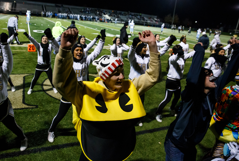 Sacred Heart-Griffin senior Matt Mosley gets in on the cheering action in his Pac-Man costume as the Cyclones take on Jerseyville during the first half of a Class 5A first round playoff game at the Sacred Heart-Griffin Sports Complex, Monday, Oct. 31, 2014, in Springfield, Ill. Justin L. Fowler/The State Journal-Register