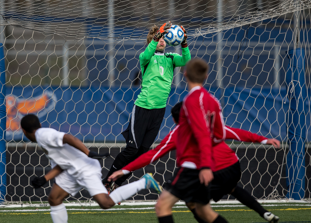 Springfield goal keeper Evan Wright (0) makes a save in front of the net against West Chicago Wheaton Academy in the first half during the IHSA Class 2A Soccer State Final Tournament semifinals at Hoffman Estates High School, Friday, Nov. 7, 2014, in Hoffman Estates, Ill. Justin L. Fowler/The State Journal-Register