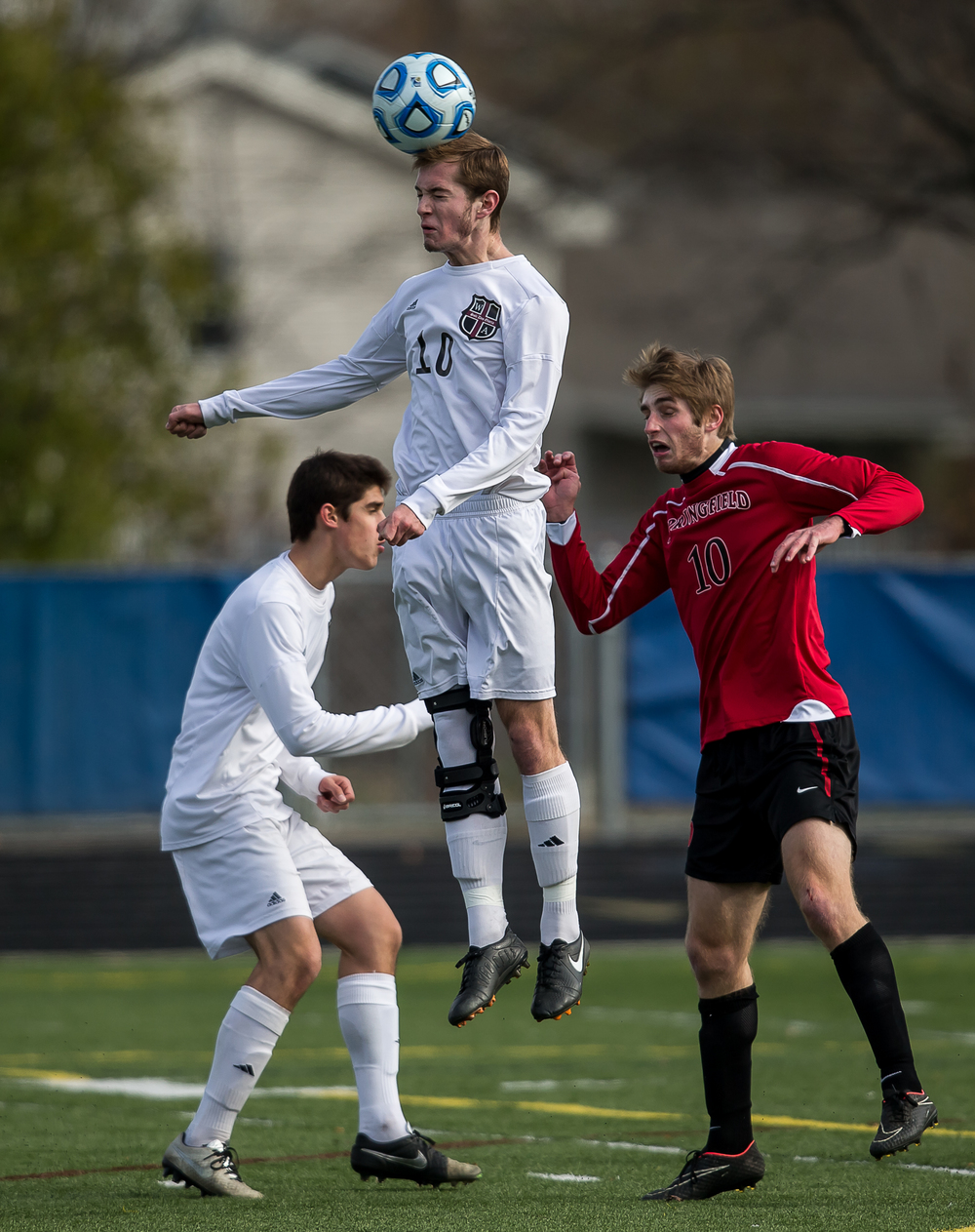 West Chicago Wheaton Academy's Jacob Kapitaniuk (10) wins a header out of the air over Springfield's Evan Kuhn (10) in the first half during the IHSA Class 2A Soccer State Final Tournament semifinals at Hoffman Estates High School, Friday, Nov. 7, 2014, in Hoffman Estates, Ill. Justin L. Fowler/The State Journal-Register
