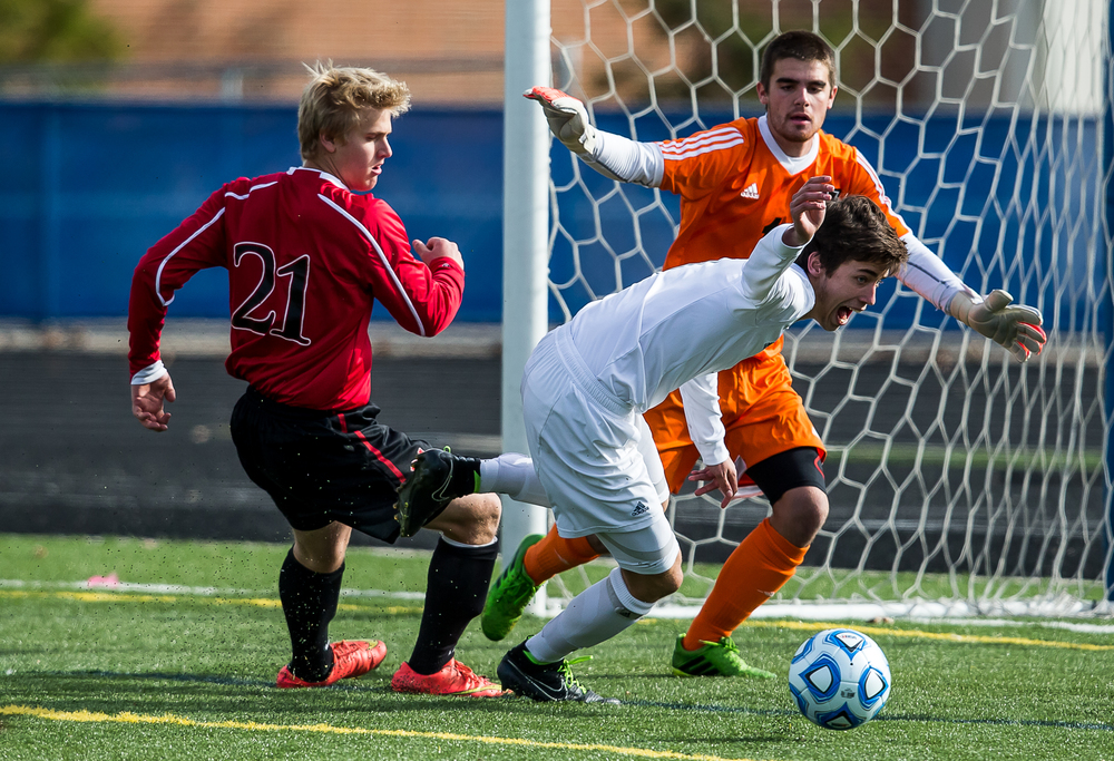 Springfield's Luke Reiser (21) has his shot blocked going against West Chicago Wheaton Academy's Hunter Finnegan (7) in the first half during the IHSA Class 2A Soccer State Final Tournament semifinals at Hoffman Estates High School, Friday, Nov. 7, 2014, in Hoffman Estates, Ill. Justin L. Fowler/The State Journal-Register