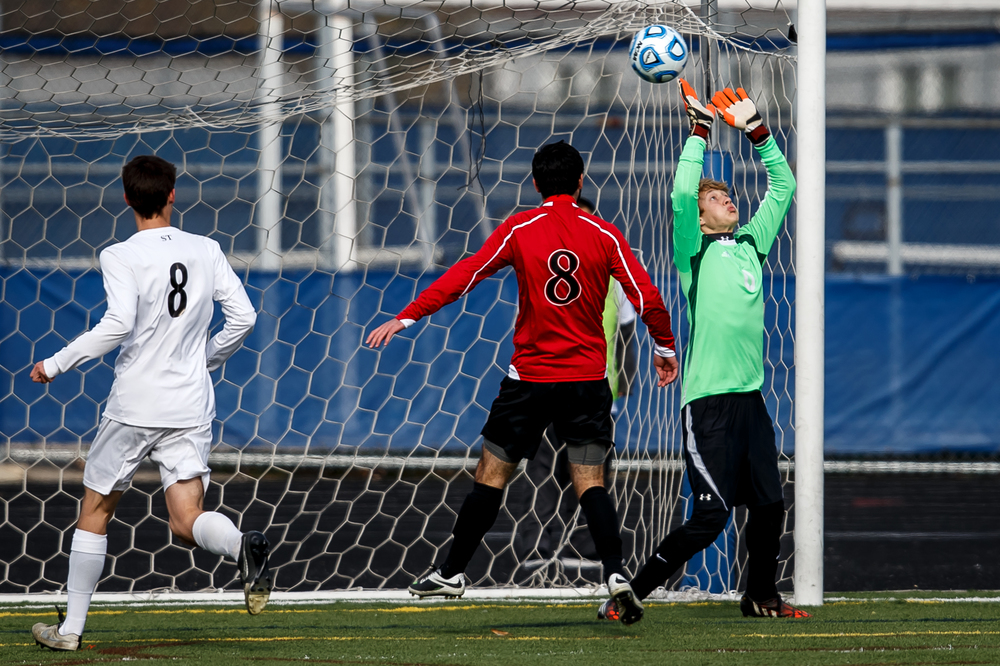 A header from West Chicago Wheaton Academy's Ty Seager (20) goes over the hands of Springfield goal keeper Evan Wright (0) to make it 1-0 in the first half during the IHSA Class 2A Soccer State Final Tournament semifinals at Hoffman Estates High School, Friday, Nov. 7, 2014, in Hoffman Estates, Ill. Justin L. Fowler/The State Journal-Register