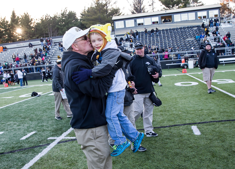 JP Leonard gets a kiss from his grandfather, Sacred Heart-Griffin head coach Ken Leonard, after the Cyclones defeated Marion 42-0 during the second round of the Class 5A playoffs at the SHG Sports Complex, Saturday, Nov. 8, 2014, in Springfield, Ill. Justin L. Fowler/The State Journal-Register