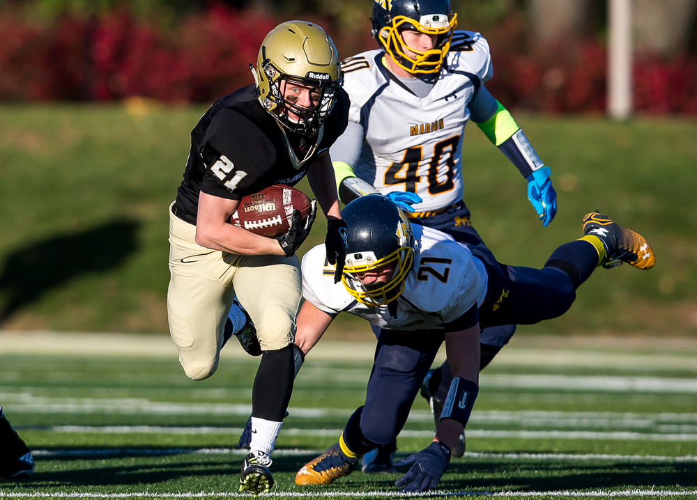 Sacred Heart-Griffin's Dylan Londrigan (21) breaks a tackle from Marion's Matt McAuliffe (21) on his way to a touchdown in the second half during the second round of the Class 5A playoffs at the SHG Sports Complex, Saturday, Nov. 8, 2014, in Springfield, Ill. Justin L. Fowler/The State Journal-Register