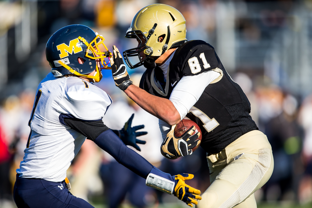 Sacred Heart-Griffin's Albert Okwuegbunam (81) plows into Marion's Zach Nave (1) after a catch in the first half during the second round of the Class 5A playoffs at the SHG Sports Complex, Saturday, Nov. 8, 2014, in Springfield, Ill. Justin L. Fowler/The State Journal-Register