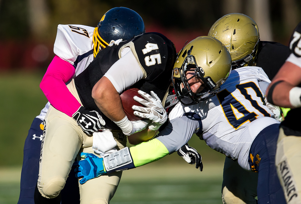 Sacred Heart-Griffin's Anthony DiNello (45) lowers his shoulder into Marion'sTommy Wilson (40) on a rush in the first half during the second round of the Class 5A playoffs at the SHG Sports Complex, Saturday, Nov. 8, 2014, in Springfield, Ill. Justin L. Fowler/The State Journal-Register