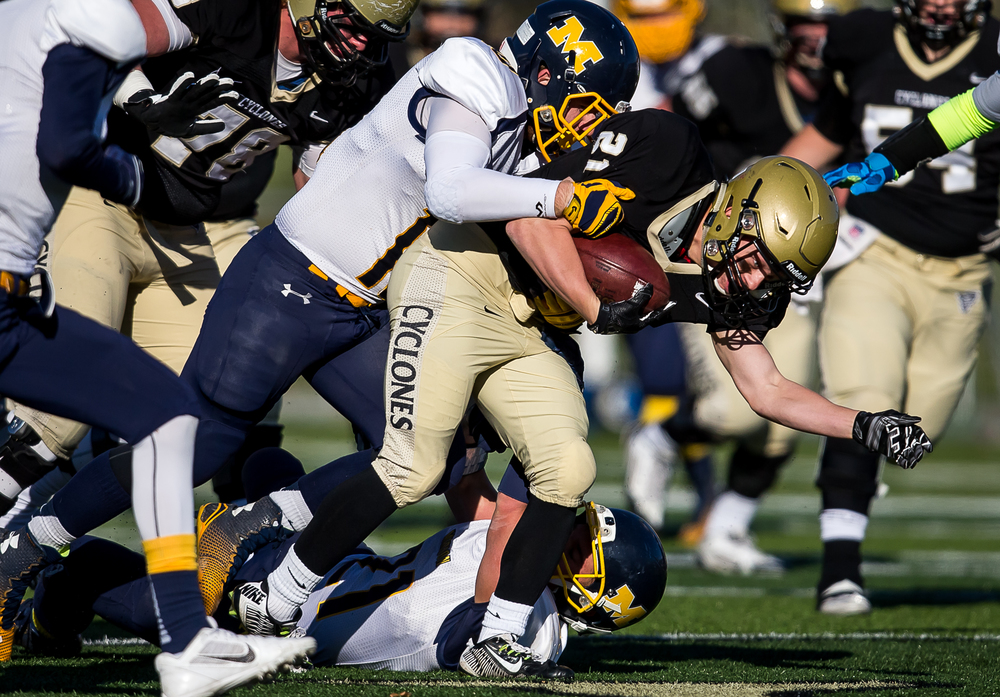 Sacred Heart-Griffin's Dylan Londrigan (21) fights for yards as Marion's Jordan Evans (10) tries to bring him down in the first half during the second round of the Class 5A playoffs at the SHG Sports Complex, Saturday, Nov. 8, 2014, in Springfield, Ill. Justin L. Fowler/The State Journal-Register
