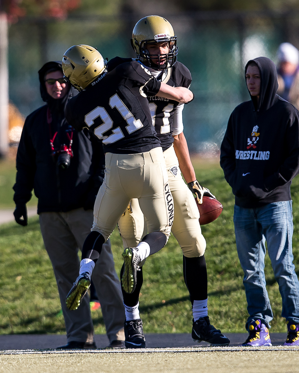 Sacred Heart-Griffin's Dylan Londrigan (21) celebrates Albert Okwuegbunam's (81) 54-yard touchdown catch against Marion in the first half during the second round of the Class 5A playoffs at the SHG Sports Complex, Saturday, Nov. 8, 2014, in Springfield, Ill. Justin L. Fowler/The State Journal-Register