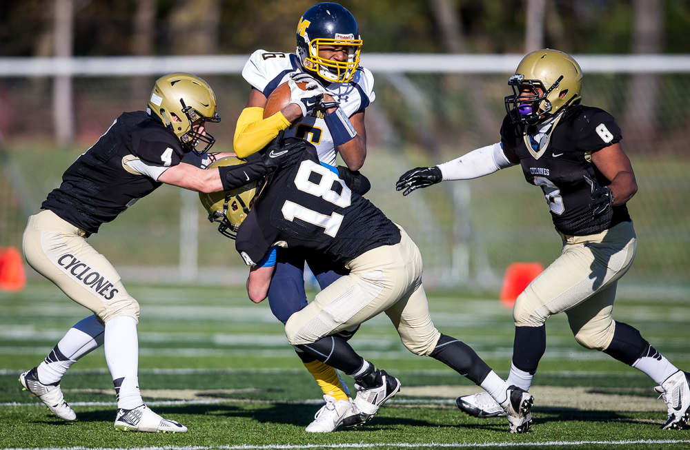Marion's Derae Andrews (6) holds on to a reception as he gets hit by Sacred Heart-Griffin's Cole Hillestad (18) in the first half during the second round of the Class 5A playoffs at the SHG Sports Complex, Saturday, Nov. 8, 2014, in Springfield, Ill. Justin L. Fowler/The State Journal-Register