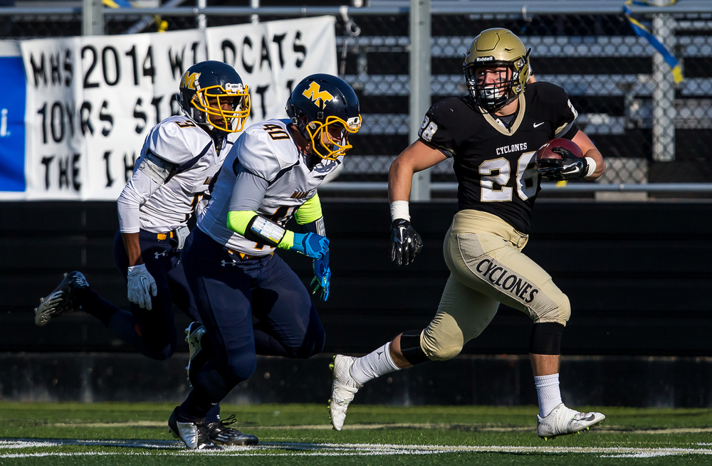 Sacred Heart-Griffin's Sam Sergent (28) looks back at the Marion defenders as he breaks on a 42-yard touchdown run in the first half during the second round of the Class 5A playoffs at the SHG Sports Complex, Saturday, Nov. 8, 2014, in Springfield, Ill. Justin L. Fowler/The State Journal-Register