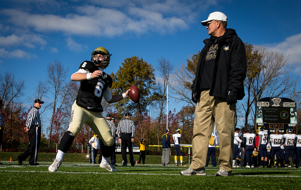 Sacred Heart-Griffin quarterback Gabe Green (6) gets warmed up along side head coach Ken Leonard prior to kickoff against Marion during the second round of the Class 5A playoffs at the SHG Sports Complex, Saturday, Nov. 8, 2014, in Springfield, Ill. Justin L. Fowler/The State Journal-Register