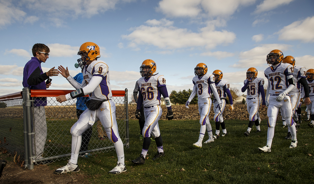 Williamsville quarterback Luke Bleyer gets a five as he and the Bullets take the field against New Berlin during the Class 3A high school football playoffs at New Berlin Saturday, Nov. 8, 2014. Ted Schurter/The State Journal-Register