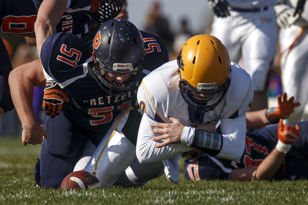 New Berlin's  Michael Spradlin tackles Williamsville quarterback Luke Bleyer as he fumbles the ball during the Class 3A high school football playoffs at New Berlin Saturday, Nov. 8, 2014. Ted Schurter/The State Journal-Register