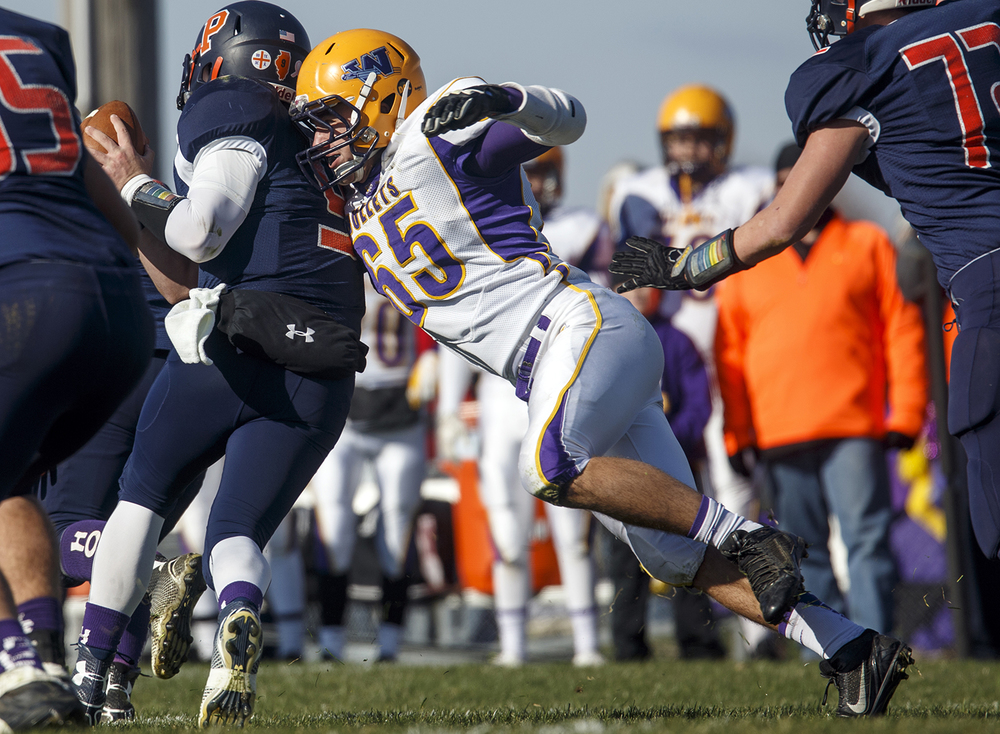 Williamsville's John Karras crashes into New Berlin quarterback Jake Hunt during the Class 3A high school football playoffs at New Berlin Saturday, Nov. 8, 2014. Ted Schurter/The State Journal-Register