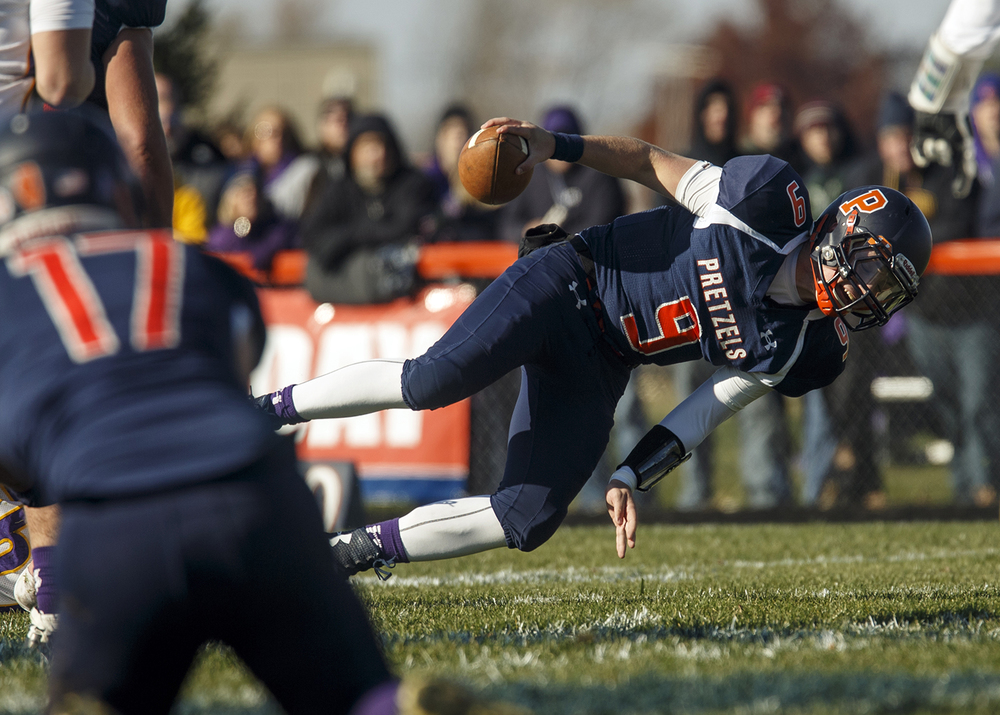 New Berlin's Jake Hunt is tripped up by the Williamsville defense  during the Class 3A high school football playoffs at New Berlin Saturday, Nov. 8, 2014. Ted Schurter/The State Journal-Register
