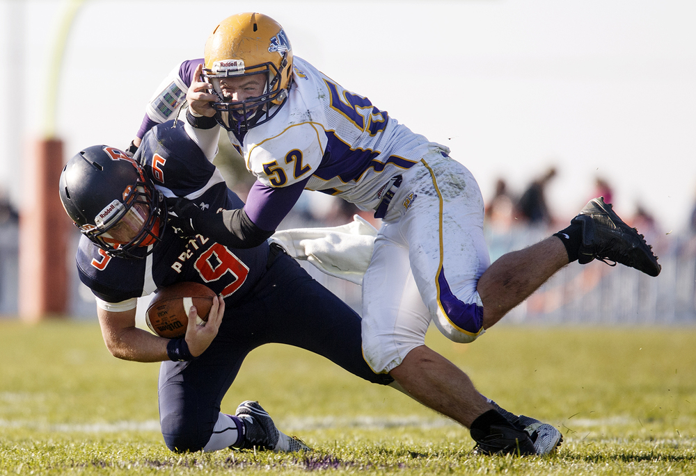 New Berlin's Jake Hunt is brought down by Williamsville's Nick Cox during the Class 3A high school football playoffs at New Berlin Saturday, Nov. 8, 2014. Ted Schurter/The State Journal-Register