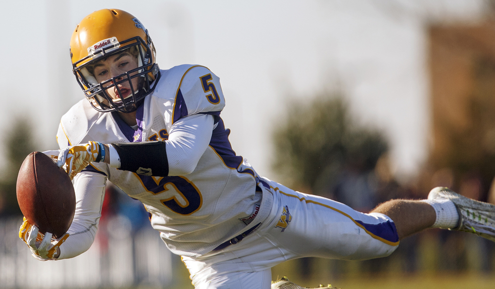 Williamsville's Vince Vignali dives for a pass against New Berlin during the Class 3A high school football playoffs at New Berlin Saturday, Nov. 8, 2014. Ted Schurter/The State Journal-Register