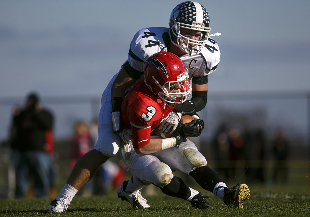 Peoria Notre Dame's Jacob Hurst smothers Chatham Glenwood's Austin Fay during a kick return during the Class 6A high school football playoffs at Chatham Glenwood Saturday, Nov. 8, 2014. Ted Schurter/The State Journal-Register