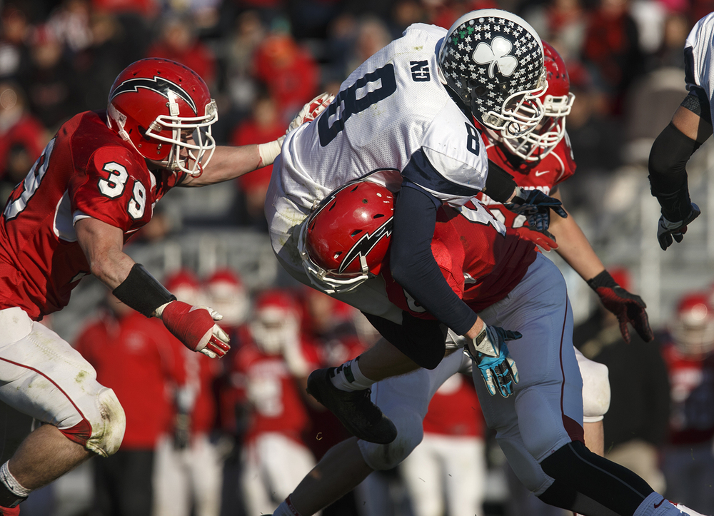 Chatham Glenwood's Nick Hammond drives under Peoria Notre Dame's David Shadid during the Class 6A high school football playoffs at Chatham Glenwood Saturday, Nov. 8, 2014. Ted Schurter/The State Journal-Register