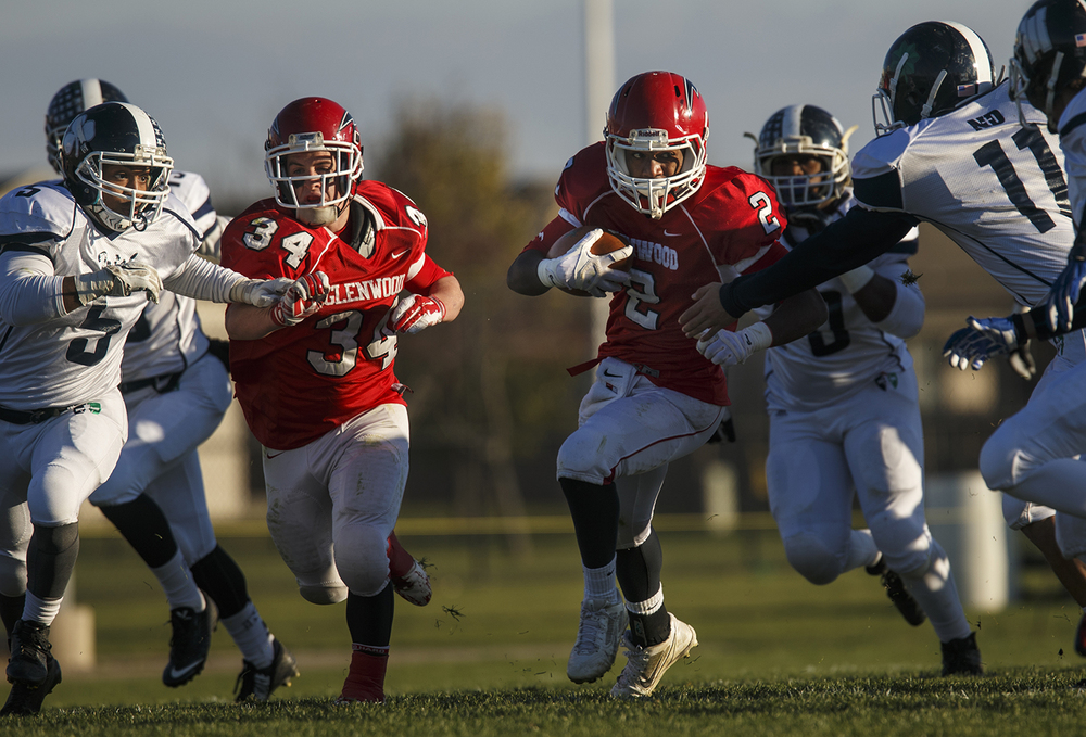 Chatham Glenwood's Josh Talley, left, blocks as teammate Airen Merrifield runs the ball upfield against Peoria Notre Dame during the Class 6A high school football playoffs at Chatham Glenwood Saturday, Nov. 8, 2014. Ted Schurter/The State Journal-Register