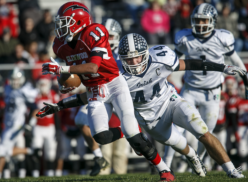 Peoria Notre Dame's Jacob Hurst closes in on Chatham Glenwood's Andrew Morrow during the Class 6A high school football playoffs at Chatham Glenwood Saturday, Nov. 8, 2014. Ted Schurter/The State Journal-Register
