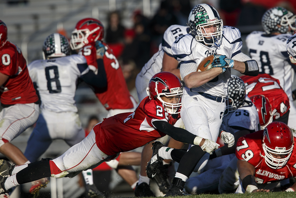 Chatham Glenwood's Drake Vonnordheim-Moore dives for Peoria Notre Dame's  Ben Barkley during the Class 6A high school football playoffs at Chatham Glenwood Saturday, Nov. 8, 2014. Ted Schurter/The State Journal-Register