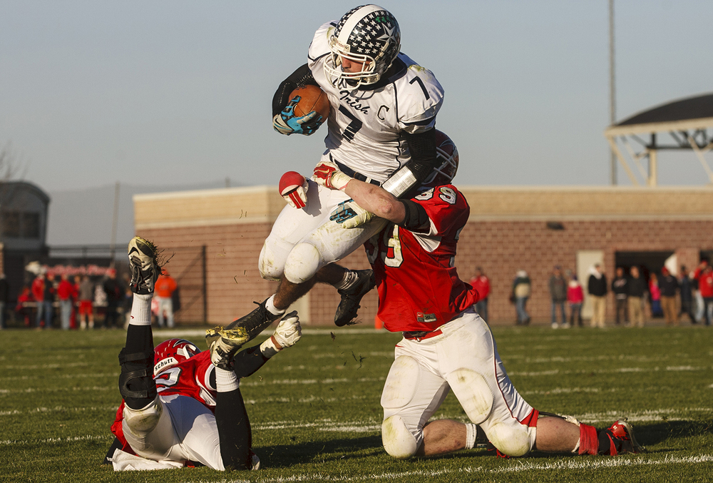 Chatham Glenwood's Airen Merrifield and J.D. Roesch try to stop Peoria Notre Dame's Andy Shadid who rushed for 263 yards and three touchdowns during the Class 6A high school football playoffs at Chatham Glenwood Saturday, Nov. 8, 2014. Ted Schurter/The State Journal-Register