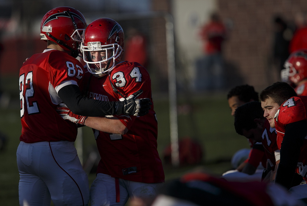 Chatham Glenwood's Brandon Hobson consoles teammate Josh Talley as time winds down on their 41-0 loss to Peoria Notre Dame during the Class 6A high school football playoffs at Chatham Glenwood Saturday, Nov. 8, 2014. Ted Schurter/The State Journal-Register