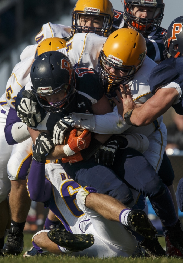 Williamsville's John Karras brings down New Berlin's Korbin Beer during the Class 3A high school football playoffs at New Berlin Saturday, Nov. 8, 2014. Ted Schurter/The State Journal-Register