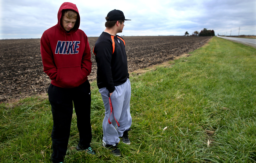 Lincolnwood High School students David Pope, left, and Zach Bormida paid respects to their classmates who died in a crash while visiting the area just south of the crash scene along Illinois 48 on Thursday, Nov. 6, 2014.  David Spencer/The State Journal-Register