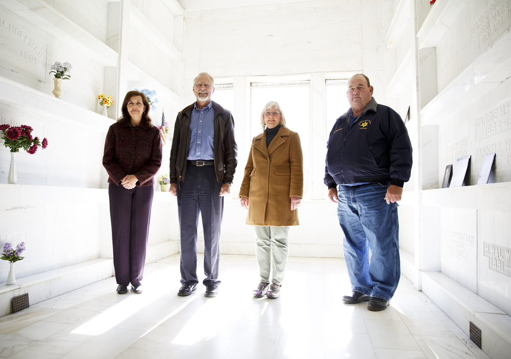 Montgomery County clerk Sandy Leitheiser, from left, Andy Ritchie, county board member Mary Brathurst and coroner Rick Broaddus have led the effort to find a final resting place for the unclaimed remains of inmates from Graham Correctional Center in Hillsboro. The group was photographed Friday, Nov. 7, 2014 in the Oak Grove Cemetery mausoleum. Rich Saal/The State Journal-Register