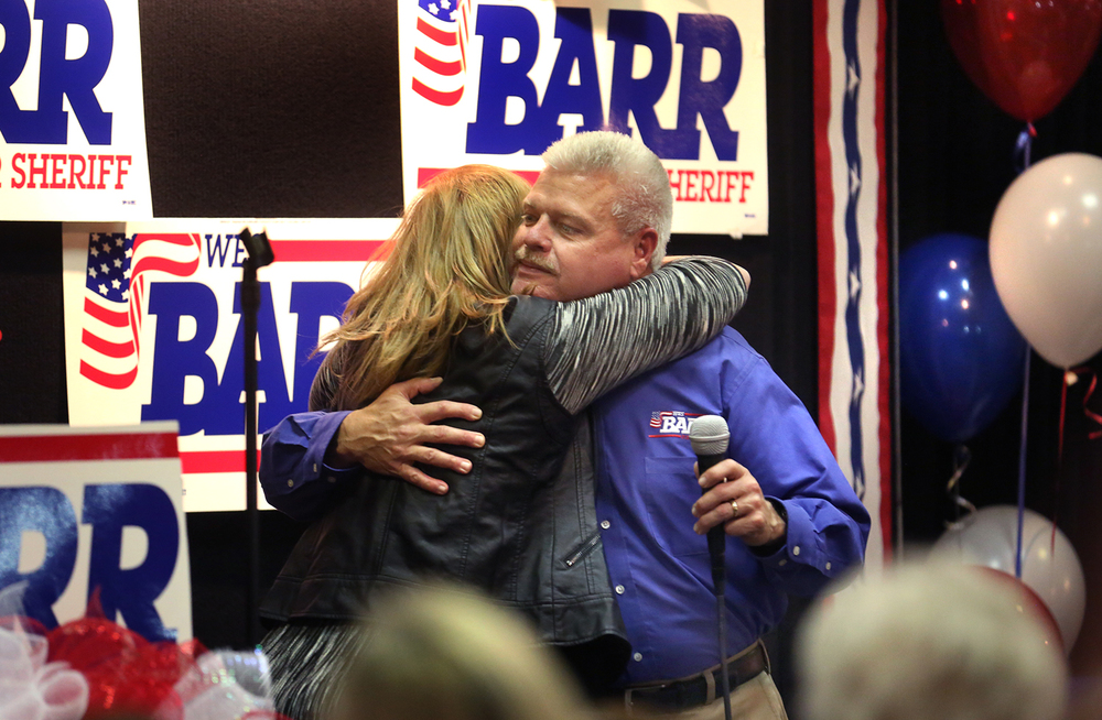 Wes Barr gives wife Sherry a hug after thanking supporters for his successful run for Sangamon County sheriff on Tuesday, Nov. 4, 2014, at his campaign party at the Route 66 Hotel & Conference Center in Springfield. David Spencer/The State Journal-Register